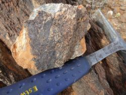 riable tin grades in sheared volcanic rocks at Black Rock prospect