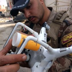 Basic cup holding mechanism for a grenade on a captured ISIS drone