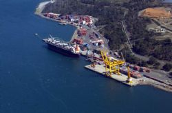 Bell Bay Port. The current ABx bauxite stockpile is located at Berth 7 where the containers are in this photo