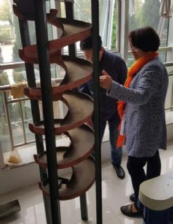 Ardiden Director, Dr. Michelle Li inspecting Spiral separation test work.