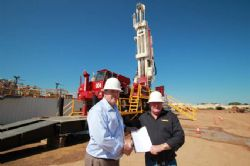 Phil Staveley, CEO of LCK with Viv Oldfield, Director of Silver City Drilling and a copy of the contract between the two South Australian based companies.