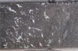 Large graphite flakes halved graphitic schist from MODD 015
