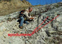 Peter Spitalny inspecting spodumene in an outcrop of one of the pegmatites at the North Aubry prospect.