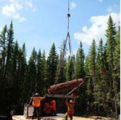 Images showing final stages of the diamond drill rig set up at the Kasagiminnis Lake Property.