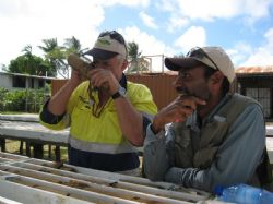 Exploration Manager Mike Woodbury and Project Geologist Kolbe Bare examining drill core.