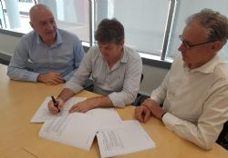 Genex COO, Arran McGhie signing the ECI contract with McConnell Dowell and Downer.