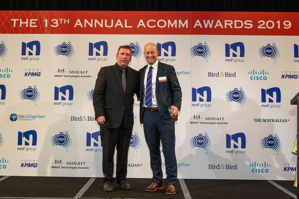 Hamish Lee, VP Sales APAC, Speedcast, receiving the ACOMMS award